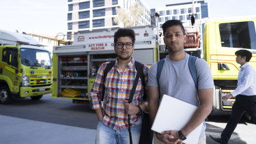 Cooper Lodge residents Aditya Jain (left) and Mudit Bhandari after they were evacuated from their residence, with police cordoning off the area