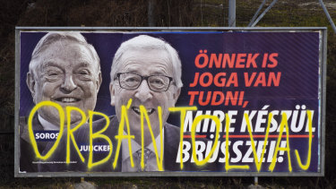 "A billboard from a campaign of the Hungarian government showing EU Commission President Jean-Claude Juncker and Hungarian-American financier George Soros with the caption ""You, too, have a right to know what Brussels is preparing to do."""