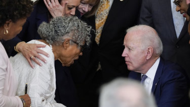 US President Joe Biden listens to 94-year-old activist Opal Lee after signing the Jbill.
