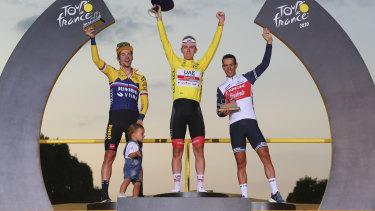 Tour de France winner Tadej Pogacar on the top step with Primoz Roglic (left) and Richie Porte (right).