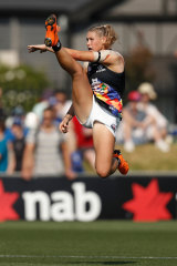 Tayla Harris in full flight. This image was removed from social media by Channel Seven but later reposted with an apology.