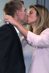 Bracing before the media showdown, David Warner gets a kiss from his wife Candace.