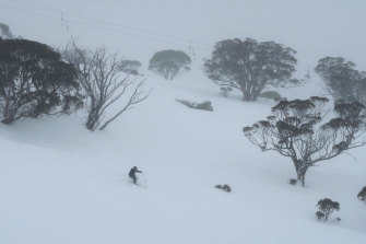 Skiers and snowboarders at Perisher as a front hitting south east Australia delivers heavy snow to the Snowy Mountains region.