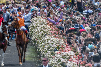 The crowd salutes Craig Williams and Vow And Declare after last year's Melbourne Cup.