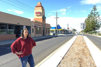Alison Murphy, owner of Central Hotel, stands on the empty streets of Lakes Entrance.