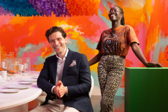 Alan Duffy and Atong Atem inside the Immigration Museum's new exhibition, Becoming You.