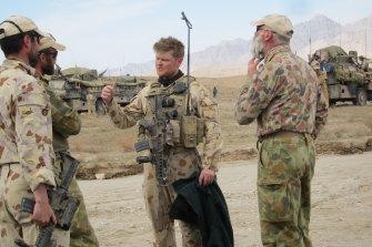 Keith Wolahan (centre) in Kandahar, Afghanistan, in February 2010.