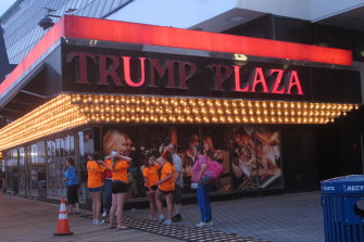a partially burnt-out sign on the exterior of the Trump Plaza casino in Atlantic City in 2014.