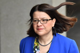 Victorian Health Minister Jenny Mikakos walks into the government's COVID-19 media conference on Friday.