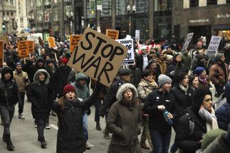 Activists march down Michigan Avenue near Trump Tower in Chicago.