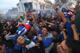 Italian soccer fans celebrate on Lygon Street, Carlton.