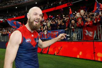 Melbourne skipper Max Gawn celebrates with fans.