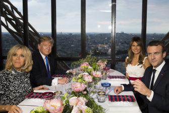 Emmanuel Macron and his wife Brigitte hosted the Trumps at a dinner at the Alain Ducasse restaurant in the Eiffel Tower in 2017.