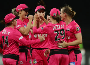 The Sixers celebrate the key wicket of Thunder star Heather Knight on Wednesday night.