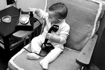 Early adopter Miss M.E. Burke gets to grips with the new number-only telephone on April 9, 1959.