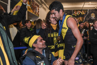 Marlion Pickett celebrates in the Richmond rooms with mother Angela and father Thomas.