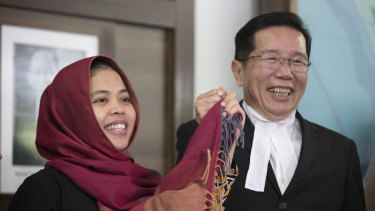 Siti Aisyah, left, smiles with her lawyer Gooi Soon Seng at a press conference after she was freed from custody.