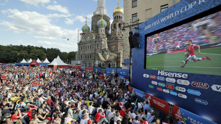 Box seats: A huge crowd watches the opening match of the 2018 World Cup between Russia and Saudi Arabia, screened at a fan zone in St.Petersburg.