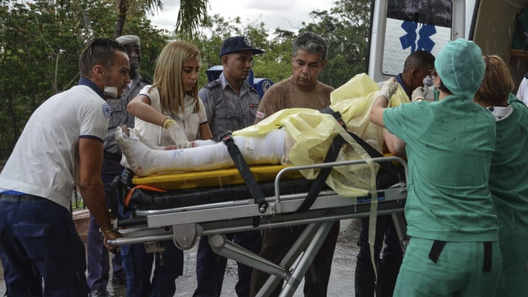 The few surviving passengers of an airliner that crashed arrive at the Calixto Garcia General Hospital in Havana.