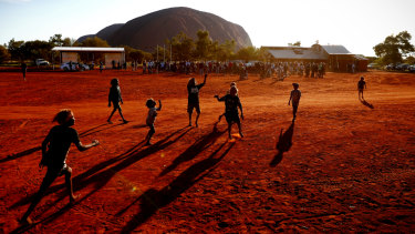 Children playing football at the First Nations National Convention at Uluru in May 2017.