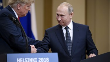 US President Donald Trump and Russian President Vladimir Putin shake hands in Helsinki, Finland, on July 11.