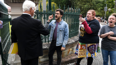 KAP federal leader Bob Katter confronts Socialist Alternative protesters at the gates of Parliament House in Brisbane.