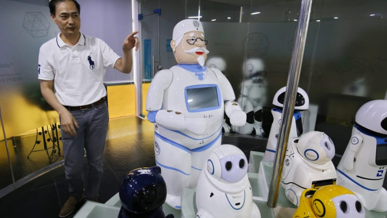 Simon Wang introduces Canbot's robot family to visitors at Canbot headquarters in Shenzhen.