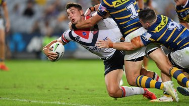 Show of strength: Victor Radley barges over against the Eels.