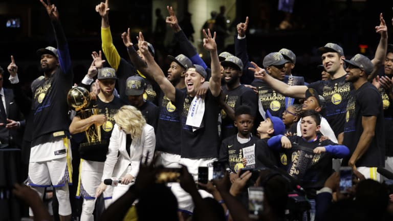 The Golden State Warriors celebrate after defeating the Cleveland Cavaliers 108-85 in Game 4.
