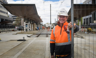 Light rail construction worker, Ross Gothard, at the close-to-complete station at Alinga Street.