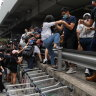 Protesters block roads near Hong Kong airport, student strike expected