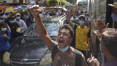 Anti-coup protesters shout slogans during a flash-mob demonstration earlier this month in Yangon, Myanmar.