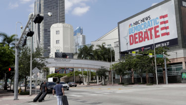 A billboard advertises the Democratic presidential debates across from the Knight Concert Hall at the Adrienne Arsht Centre in Miami.