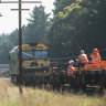 Workers onsite at Wallan to move the derailed train on Sunday.