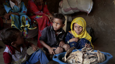 A family at a shelter in Aslam, Hajjah, Yemen. The country's humanitarian crisis is deepening, aid agencies have warned.