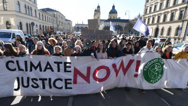 Fridays for Future protesters march through Munich's centre after a protest outside the headquarters of German engineering conglomerate Siemens which has a contract to provide systems to the Adani mine in Queensland.
