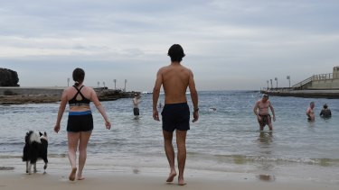 People practise social distancing during a morning swim at Clovelly Beach.