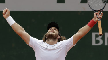 Argentina's Marco Trungelliti beats Bernard Tomic in the first round of the French Open.