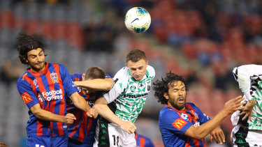 Using his head: Besart Berisha gets the best of an aerial contest for Western United.