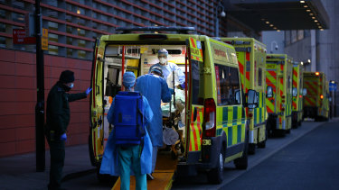 The pandemic raged through Britain. Ambulances lined up at a hospital in January.