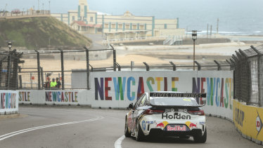 Newcastle Beach provides a stunning backdrop to Jamie Whincup on his way to victory in the Newcastle 500 on Sunday.