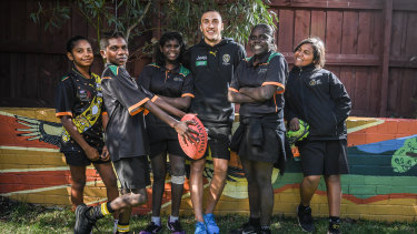 Richmond's Shai Bolton with kids from the Melbourne Indigenous Transitional School, from left. Rhiannon Baker, Adam Minjin, Serina Gurriwiwi, Pauline Managaygay and Marley Dolby.