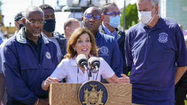 New York Governor Kathy Hochul, centre is joined by Mayor Bill de Blasio, right, during a news conference near a home where people were killed when their basement apartment was flooded in the Jamaica neighbourhood of Queens.