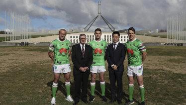 Huawei Australia chairman John Lord and chief executive Hudson Liu with Canberra Raiders players.