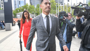 Israel Folau walking into the Federal Court in December last year.