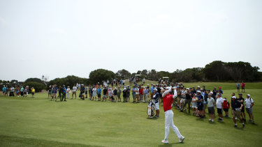 Full swing: Australia's Min Woo Lee plays his second shot on the second hole during day four.