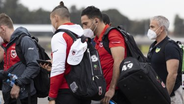 Corey Norman joins Dragons players on their flight to Queensland on Wednesday.