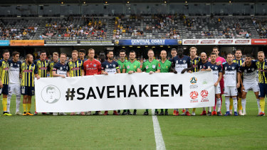 Central Coast and Melbourne Victory players show their support.