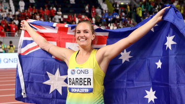 Barber can't hide her joy after overcoming a below-par qualifying round to snare gold.