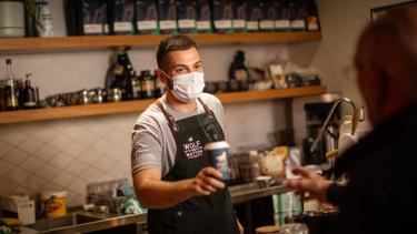 Nathan Salvalaggio serves a customer at Werribee's Wolf of Watton.